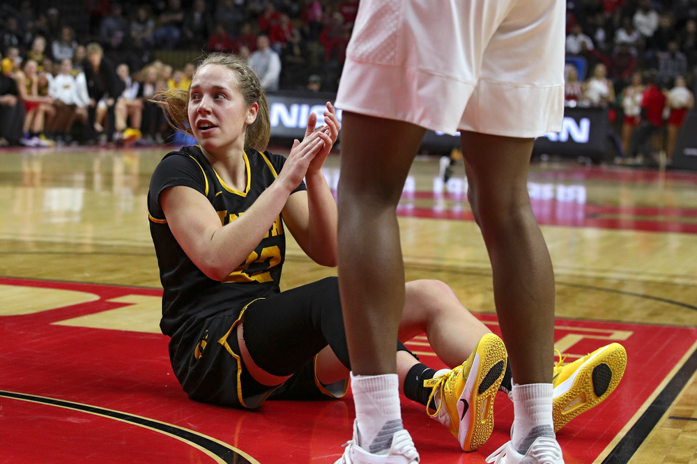 Iowa guard Kathleen Doyle (22) claps as she sits on the court after being fouled during the second quarter of their game at the Rutgers Athletic Center in Piscataway, N.J. on Sunday, March 1, 2020. (Stephen Mally/hawkeyesports.com)