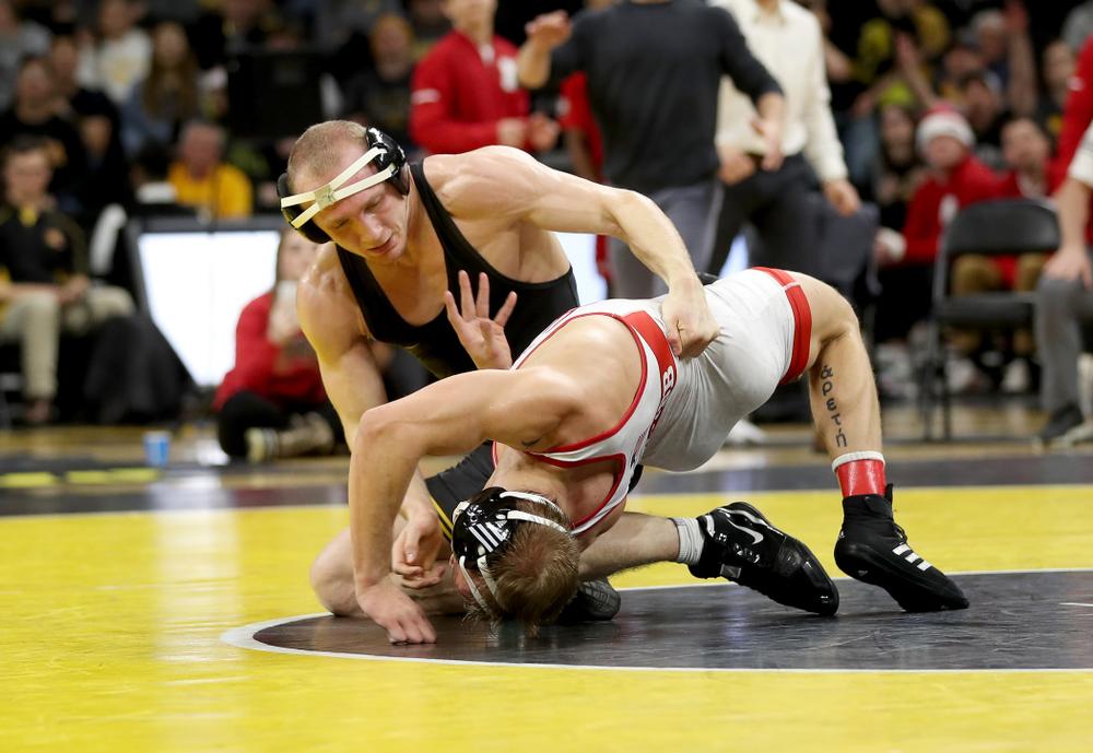 Iowa's Kaleb Young wrestles Nebraska's Peyton Rob at 157 pounds Saturday, January 18, 2020 at Carver-Hawkeye Arena. Young won the match 6-4. (Brian Ray/hawkeyesports.com)