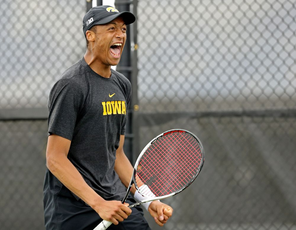 Iowa's Oliver Okonkwo celebrates as he competes during a match against Ohio State at the Hawkeye Tennis and Recreation Complex in Iowa City on Sunday, Apr. 7, 2019. (Stephen Mally/hawkeyesports.com)