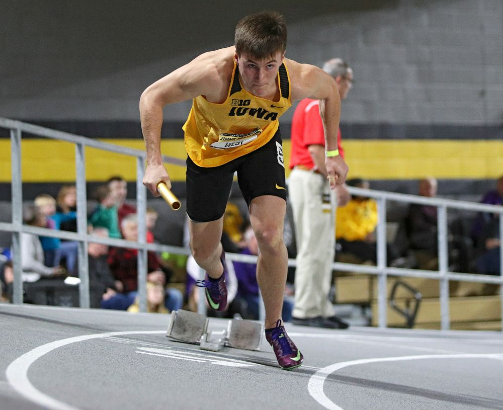 Iowa's Austin West runs the men's 1600 meter relay event during the Jimmy Grant Invitational at the Recreation Building in Iowa City on Saturday, December 14, 2019. (Stephen Mally/hawkeyesports.com)