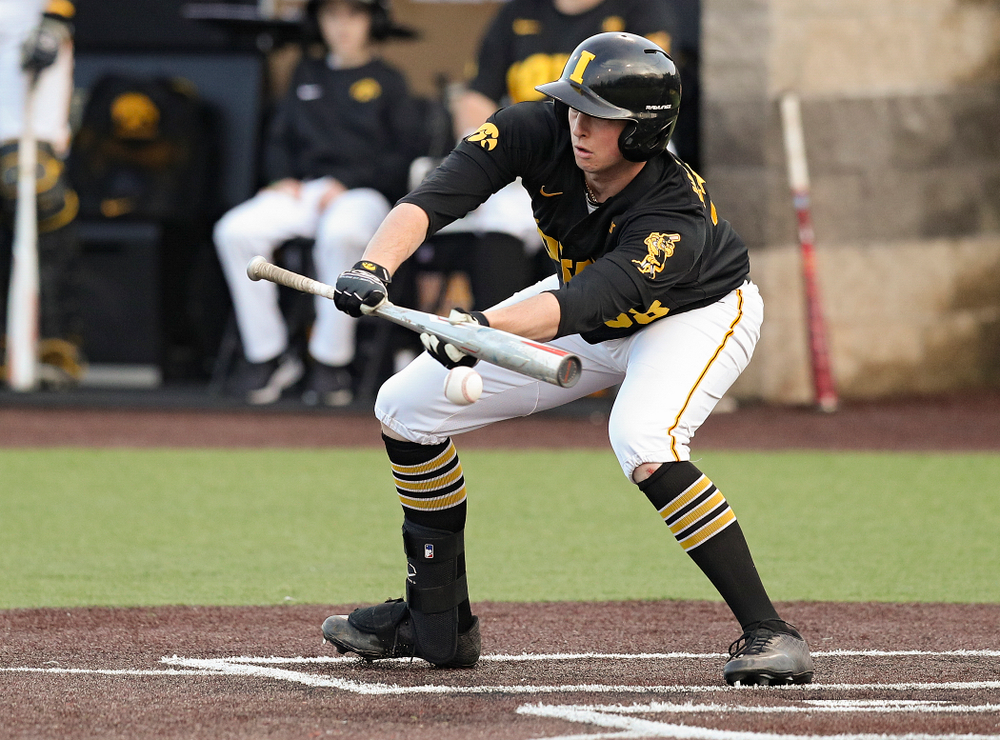 Iowa designated hitter Trenton Wallace (38) bunts the ball for a single during the seventh inning of their college baseball game at Duane Banks Field in Iowa City on Tuesday, March 10, 2020. (Stephen Mally/hawkeyesports.com)