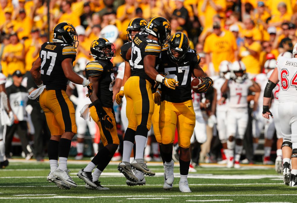 Iowa Hawkeyes defensive end Chauncey Golston (57) celebrates after recovering a fumble against the Northern Illinois Huskies Saturday, September 1, 2018 at Kinnick Stadium. (Brian Ray/hawkeyesports.com)
