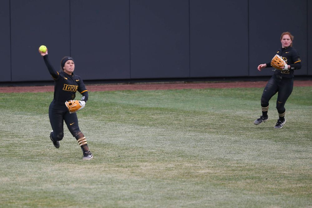 Iowa outfielder Lea Thompson (7) and Iowa's Kate Claypool (12) at game 2 vs Northwestern on Saturday, March 30, 2019 at Bob Pearl Field. (Lily Smith/hawkeyesports.com)