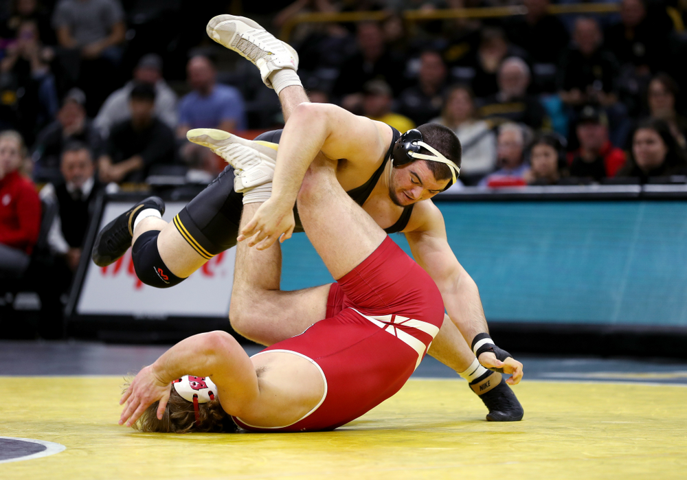 IowaÕs Tony Cassioppi wrestles WisconsinÕs Trent Hillger at heavyweight Sunday, December 1, 2019 at Carver-Hawkeye Arena. Cassioppi won the match 3-2. (Brian Ray/hawkeyesports.com)
