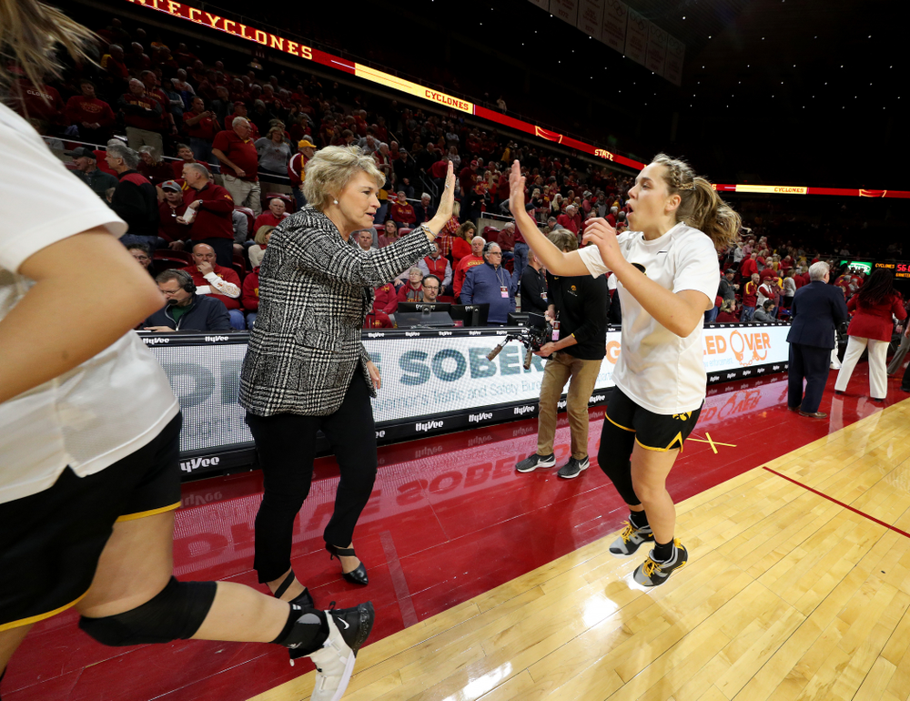 Iowa Hawkeyes head coach Lisa Bluder and guard Kathleen Doyle (22) against the Iowa State Cyclones Wednesday, December 11, 2019 at Hilton Coliseum in Ames, Iowa(Brian Ray/hawkeyesports.com)