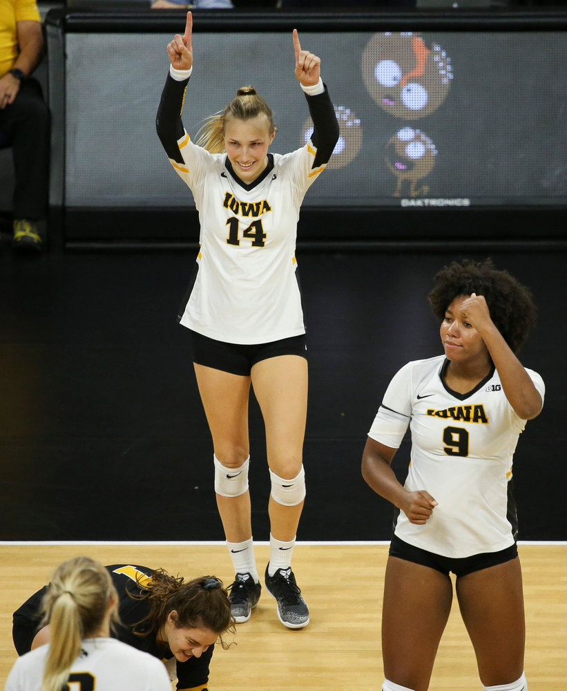 Iowa Hawkeyes outside hitter Cali Hoye (14) and Iowa Hawkeyes middle blocker Amiya Jones (9) reacts after a kill during a game against Purdue at Carver-Hawkeye Arena on October 13, 2018. (Tork Mason/hawkeyesports.com)