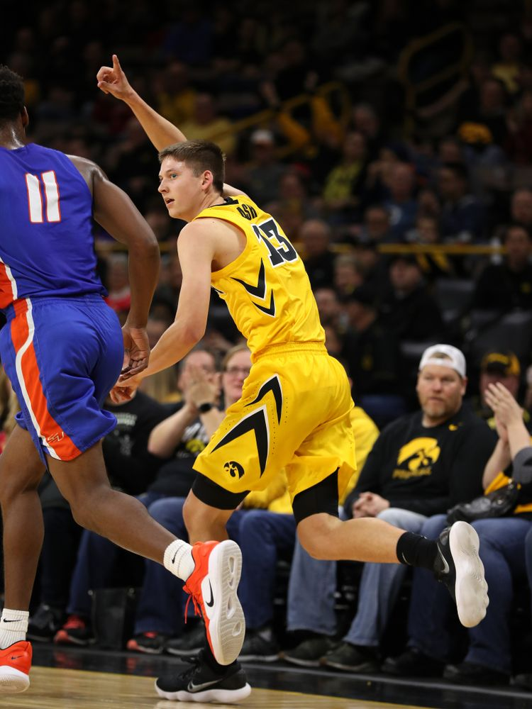 Iowa Hawkeyes guard Austin Ash (13) against the Savannah State Tigers Saturday, December 22, 2018 at Carver-Hawkeye Arena. (Brian Ray/hawkeyesports.com)