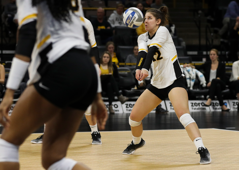 Iowa Hawkeyes defensive specialist Emily Bushman (12) bumps the ball during a match against Maryland at Carver-Hawkeye Arena on November 23, 2018. (Tork Mason/hawkeyesports.com)