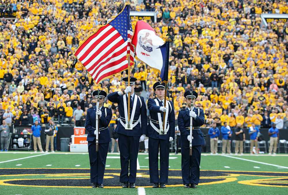 The color guard presents the flags for the National Anthem 
