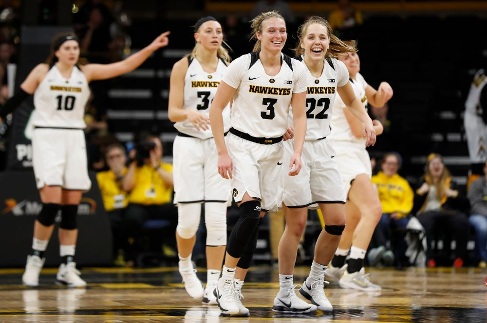 Iowa Hawkeyes guard Makenzie Meyer (3) and guard Kathleen Doyle (22)