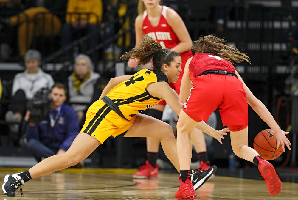 Iowa Hawkeyes guard Gabbie Marshall (24) knocks the ball away from Ohio State Buckeyes guard Jacy Sheldon (4) during the first quarter of their game at Carver-Hawkeye Arena in Iowa City on Thursday, January 23, 2020. (Stephen Mally/hawkeyesports.com)