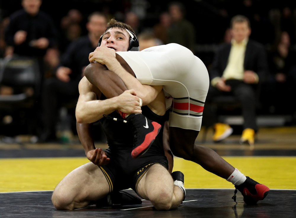 Iowa's Austin DeSanto wrestles Ohio State's Jordan Decatur at 133 pounds Friday, January 24, 2020 at Carver-Hawkeye Arena. DeSanto won the match with a 21-3 tech fall. (Brian Ray/hawkeyesports.com)