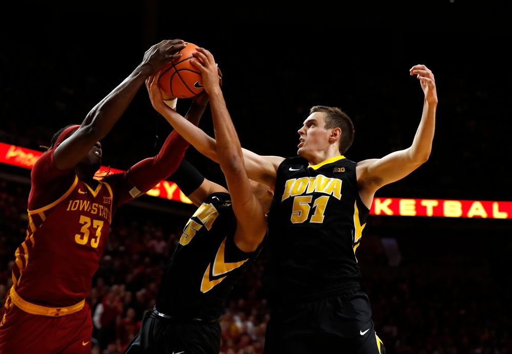 Iowa Hawkeyes forward Cordell Pemsl (35), and forward Nicholas Baer (51)