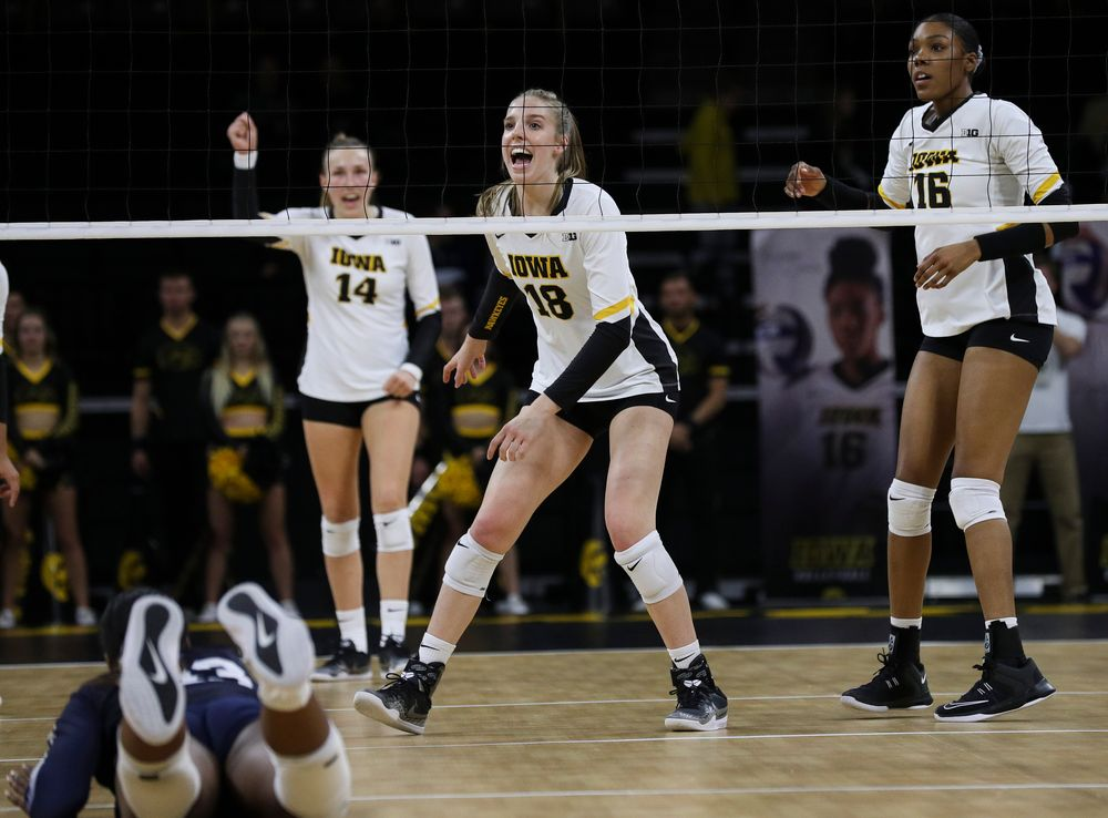 Iowa Hawkeyes middle blocker Hannah Clayton (18) celebrates after winning a point during a match against Penn State at Carver-Hawkeye Arena on November 3, 2018. (Tork Mason/hawkeyesports.com)