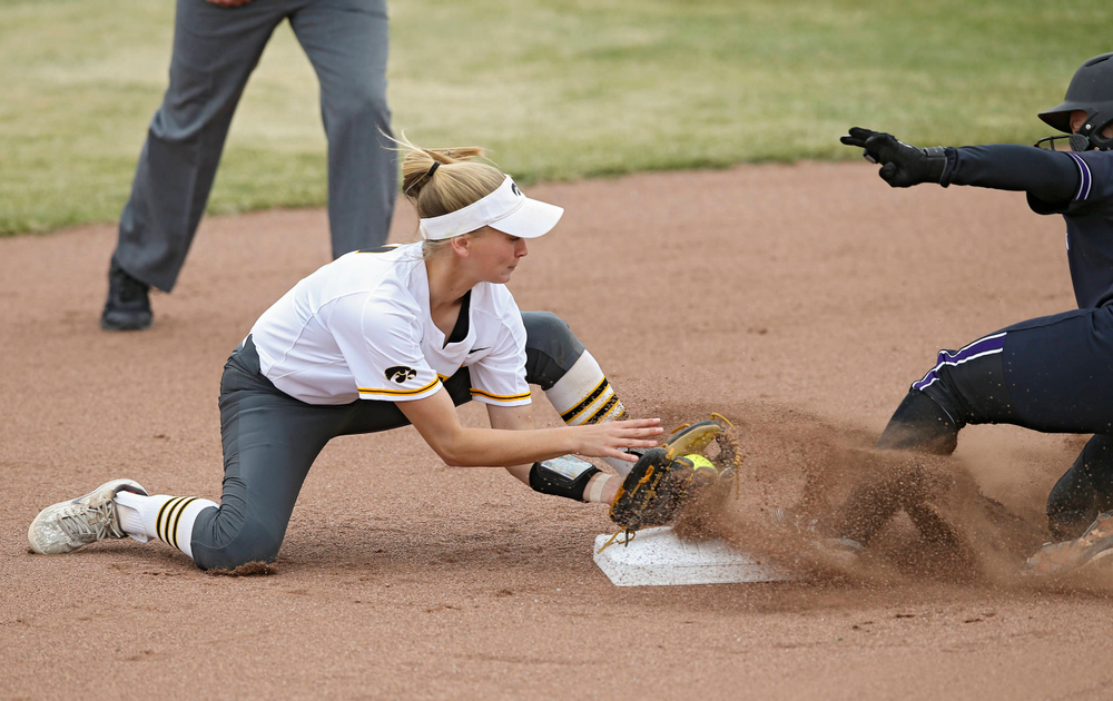 Iowa Hawkeyes Aralee Bogar (2) tries for a tag at second base during the first inning of their Big Ten Conference softball game at Pearl Field in Iowa City on Friday, Mar. 29, 2019. (Stephen Mally/hawkeyesports.com)