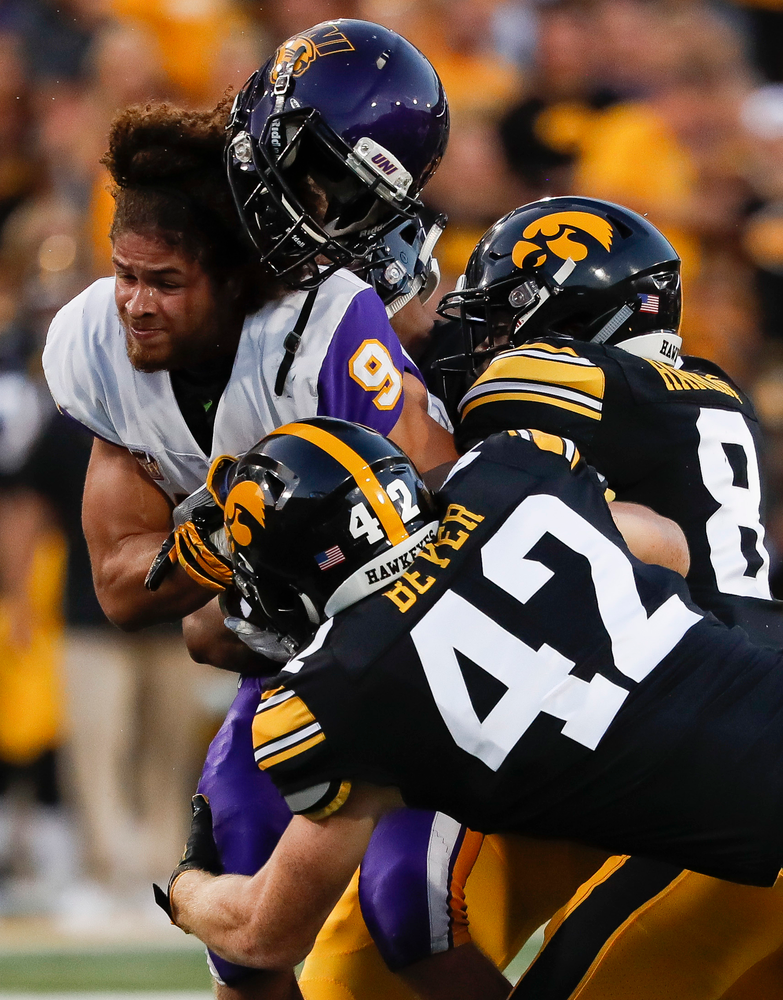 Iowa Hawkeyes tight end Shaun Beyer (42) and Iowa Hawkeyes defensive back Matt Hankins (8) tackle Northern Iowa's Xavier Williams (9) on a kickoff during a game against Northern Iowa at Kinnick Stadium on September 15, 2018. (Tork Mason/hawkeyesports.com)