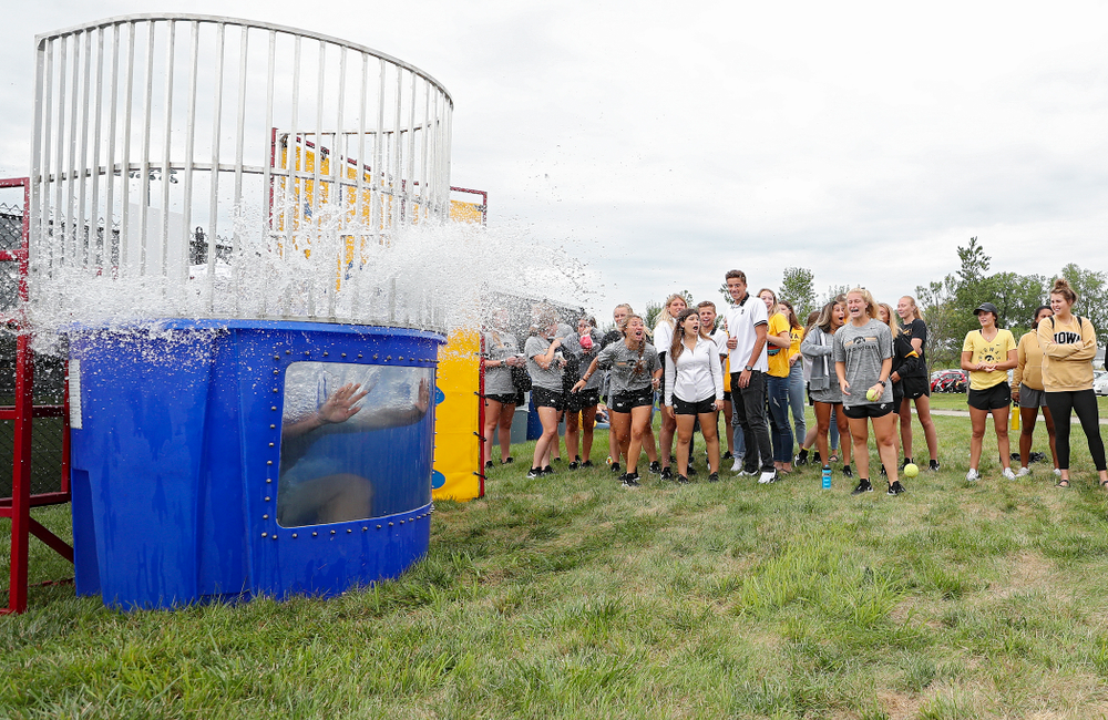 Iowa Track and Field assistant coach Eric Werskey drops into the water in the dunk tank during the Student-Athlete Kickoff outside the Karro Athletics Hall of Fame Building in Iowa City on Sunday, Aug 25, 2019. (Stephen Mally/hawkeyesports.com)