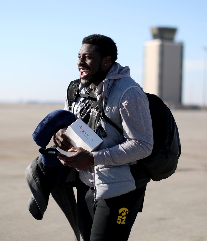 Iowa Hawkeyes linebacker Amani Jones (52) boards the team plane at the Eastern Iowa Airport Saturday, December 21, 2019 on the way to San Diego, CA for the Holiday Bowl. (Brian Ray/hawkeyesports.com)
