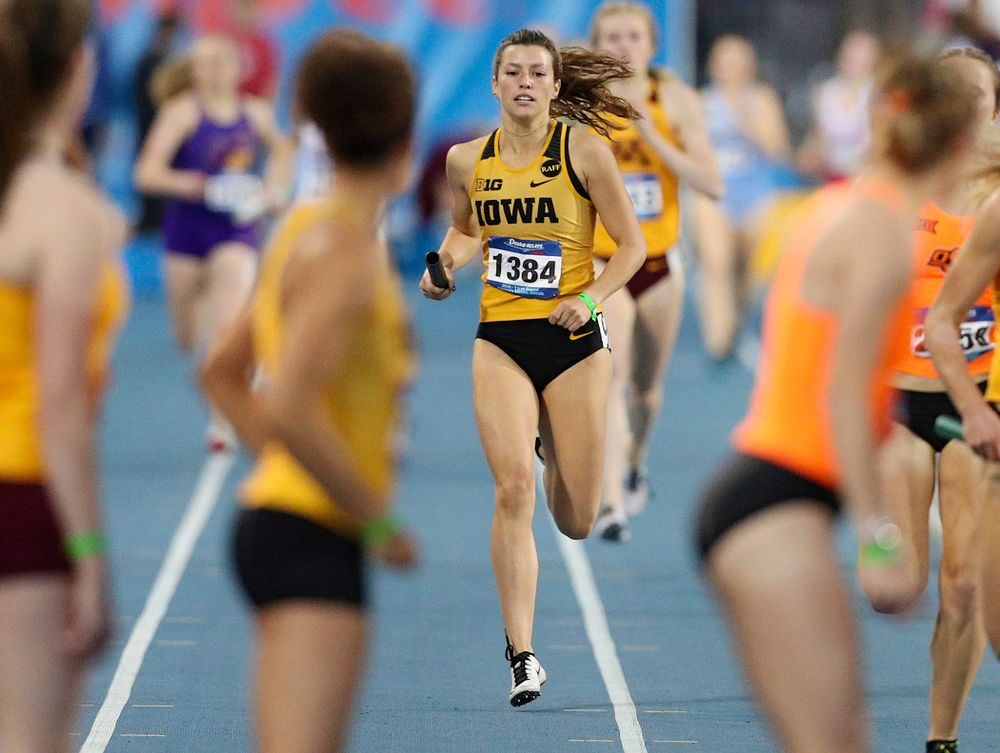 Iowa's Taylor Arco prepares to hand off the baton to Tia Saunders runs the women's 3200 meter relay event during the second day of the Drake Relays at Drake Stadium in Des Moines on Friday, Apr. 26, 2019. (Stephen Mally/hawkeyesports.com)