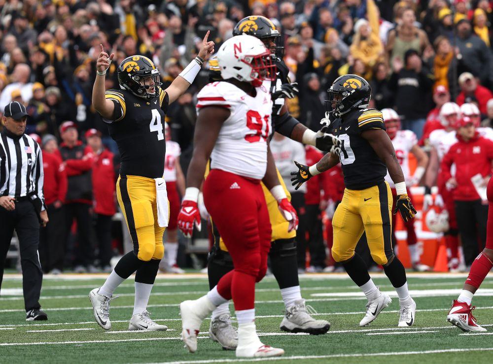 Iowa Hawkeyes quarterback Nate Stanley (4) celebrates a touchdown pass to wide receiver Brandon Smith (12)  against the Nebraska Cornhuskers Friday, November 23, 2018 at Kinnick Stadium. (Brian Ray/hawkeyesports.com)