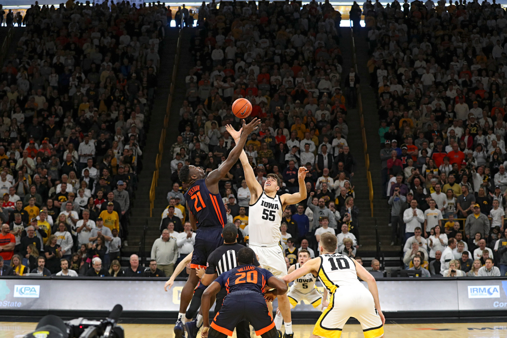 Iowa Hawkeyes center Luka Garza (55) battles for the opening tip off during the first quarter of the game at Carver-Hawkeye Arena in Iowa City on Sunday, February 2, 2020. (Stephen Mally/hawkeyesports.com)