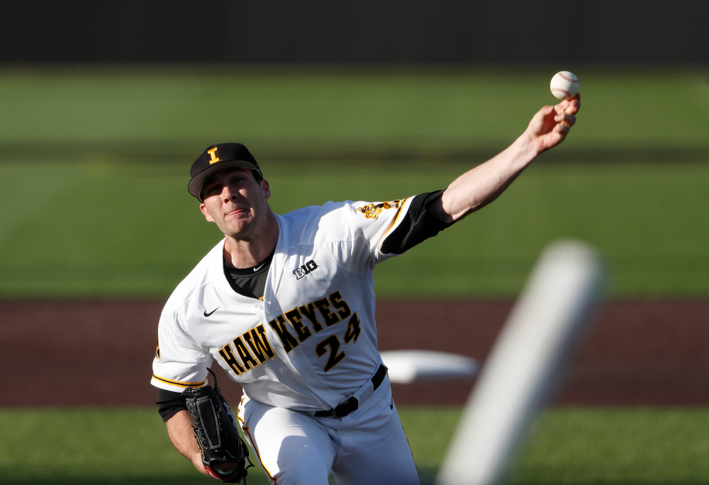 Iowa Hawkeyes pitcher Nick Allgeyer (24) delivers the ball to the plate against the Michigan Wolverines Friday, April 27, 2018 at Duane Banks Field in Iowa City. (Brian Ray/hawkeyesports.com)