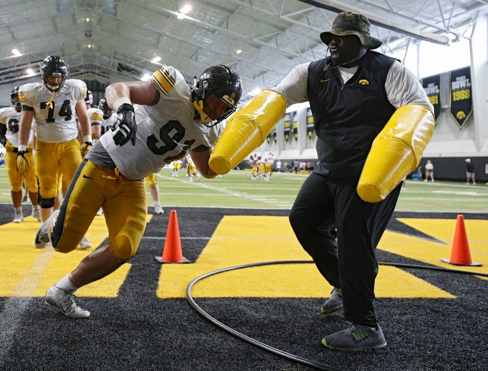 Iowa Hawkeyes defensive lineman Brady Reiff (91) works on a drill with defensive line coach Kelvin Bell during Fall Camp Practice No. 6 at the Hansen Football Performance Center in Iowa City on Thursday, Aug 8, 2019. (Stephen Mally/hawkeyesports.com)