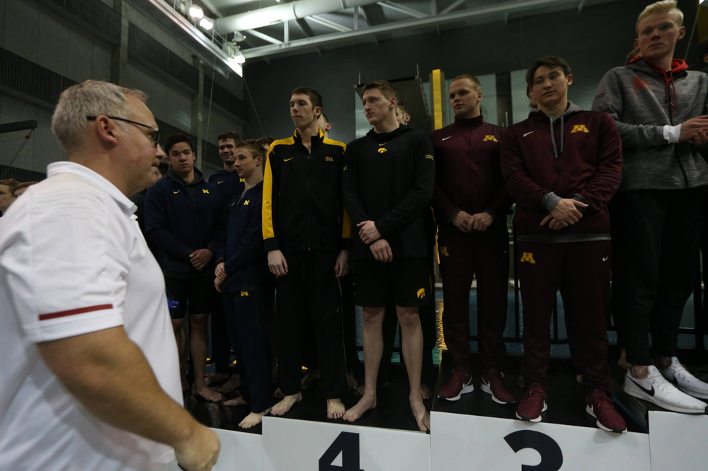 Iowa's  Joe Myhre, Jack Smith, Will Scott, and Steve Fiolic after the 200-yard freestyle relay race  Friday, March 1, 2019 at the Campus Recreation and Wellness Center. (Lily Smith/hawkeyesports.com)