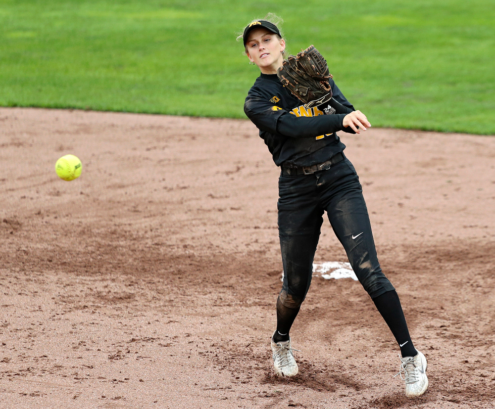 Iowa infielder Mia Ruther (26) throws to first for an out during the sixth inning of their game against Iowa Softball vs Indian Hills Community College at Pearl Field in Iowa City on Sunday, Oct 6, 2019. (Stephen Mally/hawkeyesports.com)