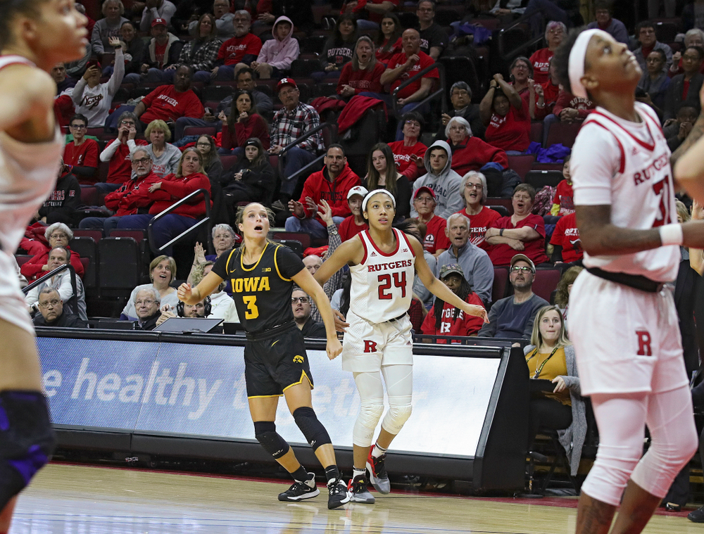Iowa guard Makenzie Meyer (3) watches her 3-pointer sail into the basket during the fourth quarter of their game at the Rutgers Athletic Center in Piscataway, N.J. on Sunday, March 1, 2020. (Stephen Mally/hawkeyesports.com)