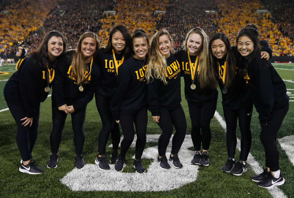 Members of the Iowa women's gymnastics team are recognized by the Presidential Committee on Athletics at halftime during a game against Wisconsin on September 22, 2018. (Tork Mason/hawkeyesports.com)