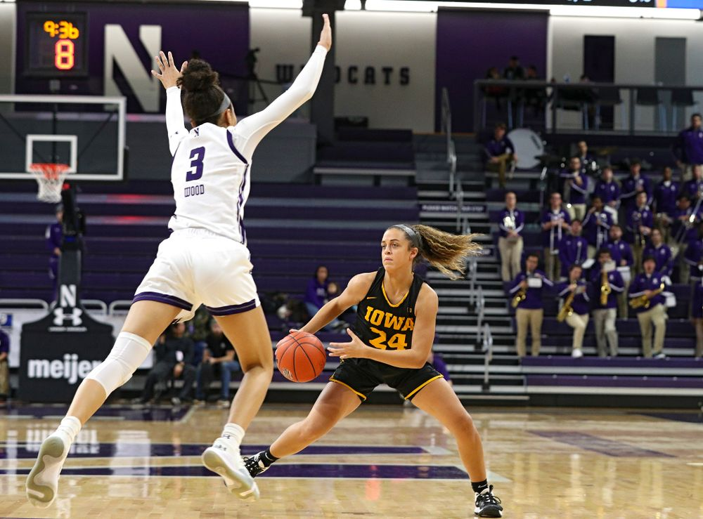 Iowa Hawkeyes guard Gabbie Marshall (24) jukes Northwestern Wildcats guard Sydney Wood (3) during the second quarter of their game at Welsh-Ryan Arena in Evanston, Ill. on Sunday, January 5, 2020. (Stephen Mally/hawkeyesports.com)