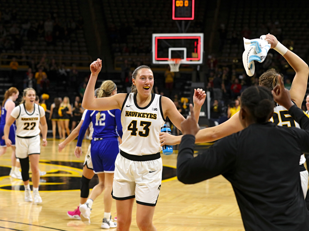 Iowa Hawkeyes forward Amanda Ollinger (43) celebrates with her teammates after their game at Carver-Hawkeye Arena in Iowa City on Saturday, December 21, 2019. (Stephen Mally/hawkeyesports.com)