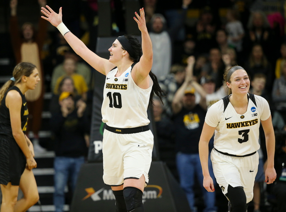 Iowa Hawkeyes center Megan Gustafson (10) pumps up the crowd as guard Makenzie Meyer (3) looks on during the fourth quarter of their second round game in the 2019 NCAA Women's Basketball Tournament at Carver Hawkeye Arena in Iowa City on Sunday, Mar. 24, 2019. (Stephen Mally for hawkeyesports.com)