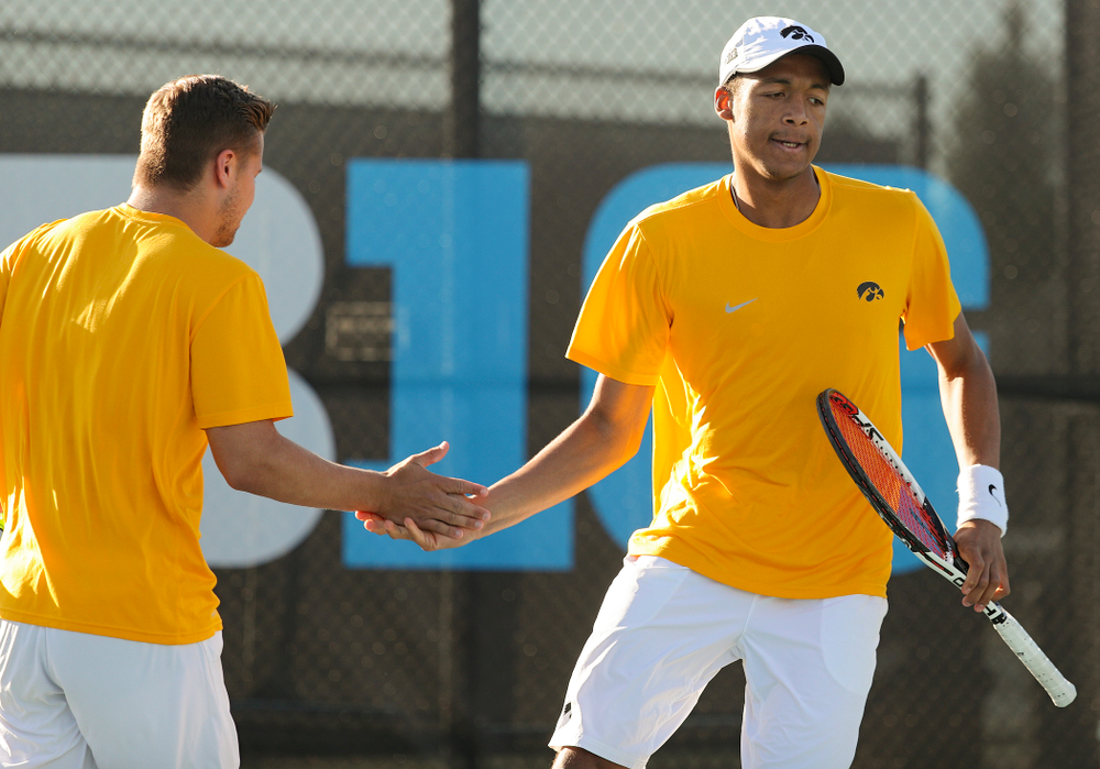 Iowa's Will Davies (from left) and Oliver Okonkwo celebrate a point during their doubles match again Michigan State at the Hawkeye Tennis and Recreation Complex in Iowa City on Friday, Apr. 19, 2019. (Stephen Mally/hawkeyesports.com)
