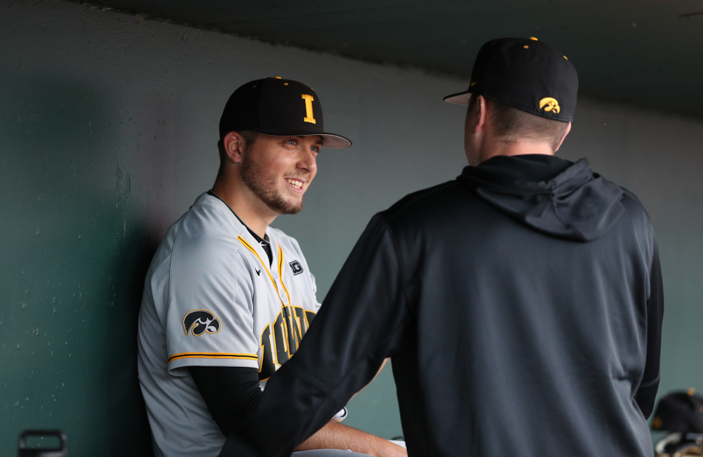 Iowa Hawkeyes Cole McDonald (11) talks with pitching coach Tom Gorzelanny against the Indiana Hoosiers in the first round of the Big Ten Baseball Tournament Wednesday, May 22, 2019 at TD Ameritrade Park in Omaha, Neb. (Brian Ray/hawkeyesports.com)