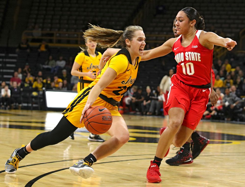 Iowa Hawkeyes guard Kathleen Doyle (22) drives on Ohio State Buckeyes guard Braxtin Miller (10) during the third quarter of their game at Carver-Hawkeye Arena in Iowa City on Thursday, January 23, 2020. (Stephen Mally/hawkeyesports.com)