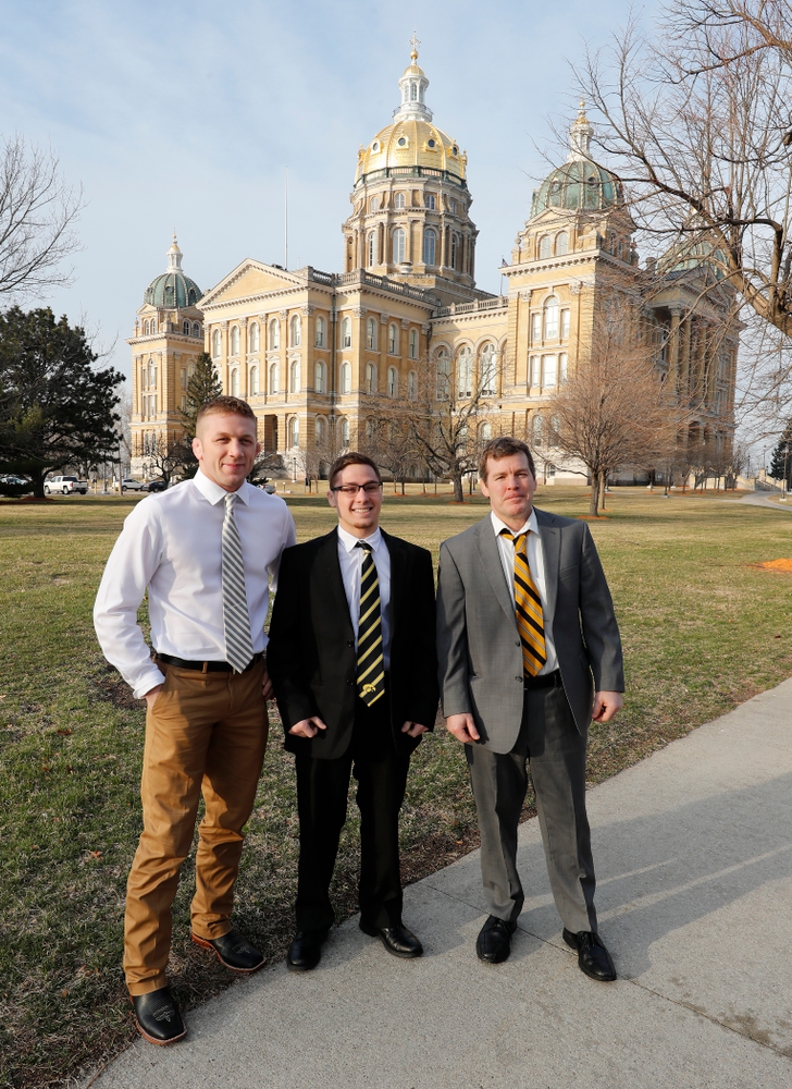 Hawkeye Wrestling head coach Tom Brands, assistant coach Ryan Morningstar, and national champion at 125 pounds Spencer Lee