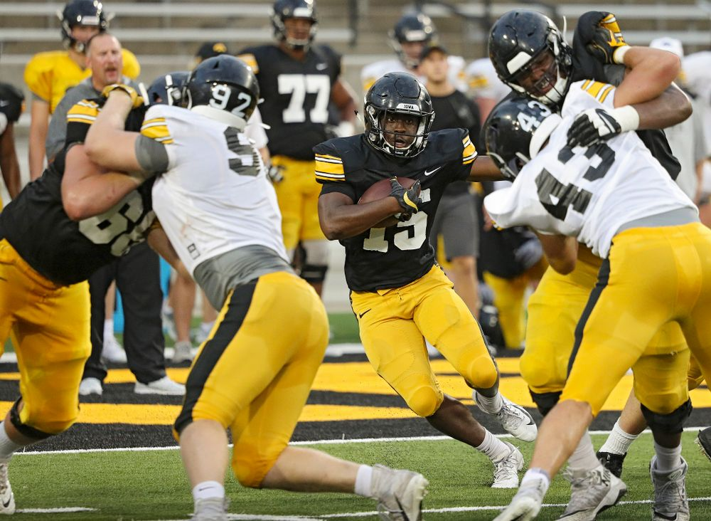 Iowa Hawkeyes running back Tyler Goodson (15) looks for running room during Fall Camp Practice No. 12 at Kinnick Stadium in Iowa City on Thursday, Aug 15, 2019. (Stephen Mally/hawkeyesports.com)