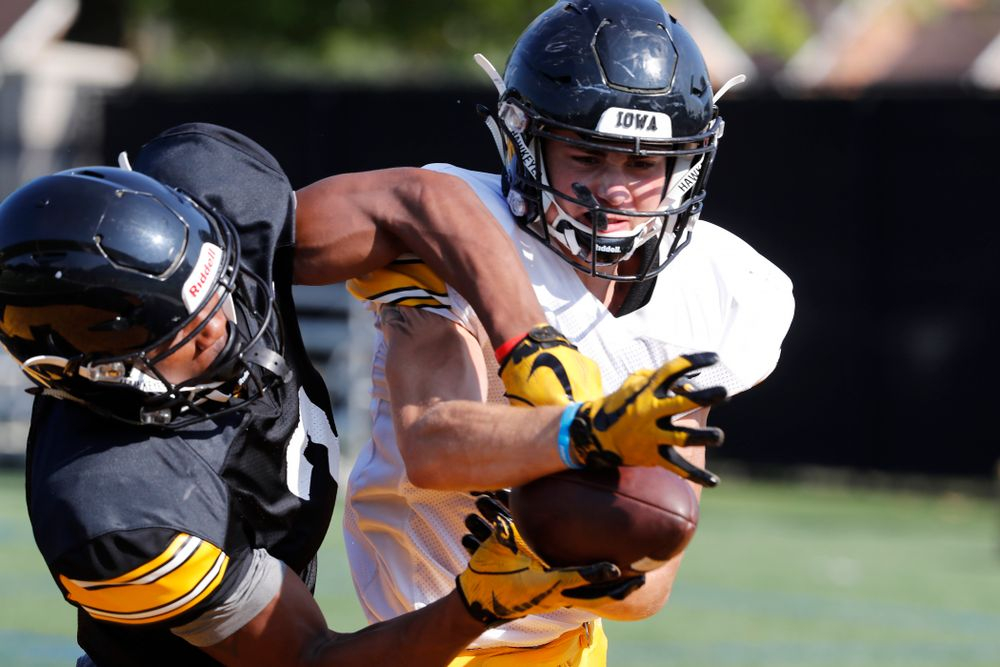 Iowa Hawkeyes defensive back Riley Moss (33) and wide receiver Tyrone Tracy Jr. (3) during camp practice No. 17 Wednesday, August 22, 2018 at the Kenyon Football Practice Facility. (Brian Ray/hawkeyesports.com)