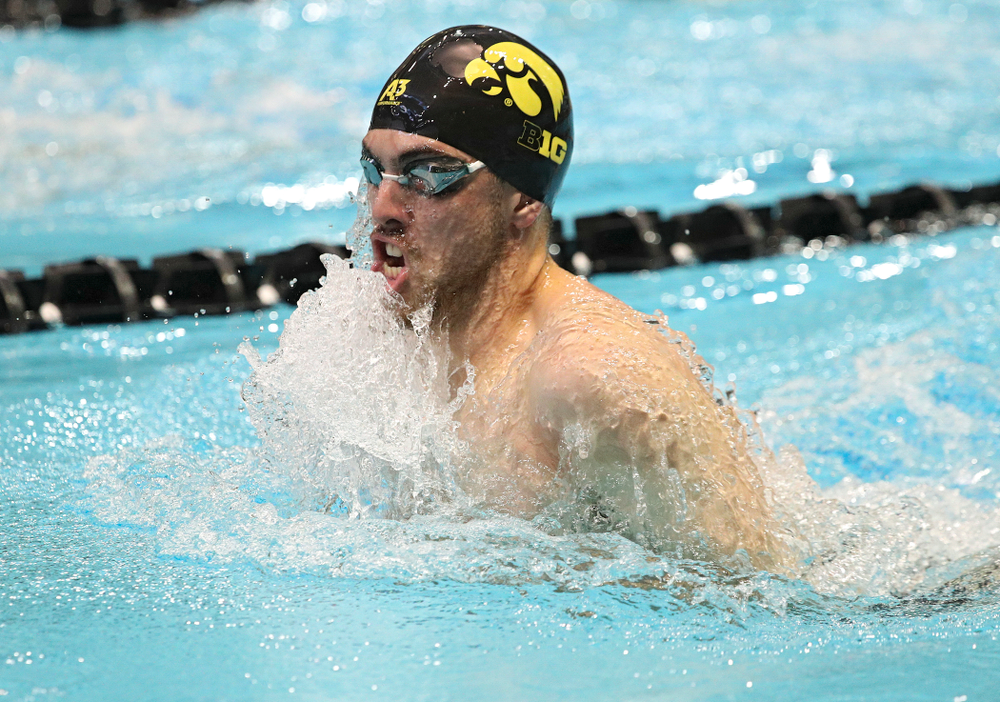 Iowa's Weston Credit swims the men's 100-yard breaststroke event during their meet against Michigan State and Northern Iowa at the Campus Recreation and Wellness Center in Iowa City on Friday, Oct 4, 2019. (Stephen Mally/hawkeyesports.com)