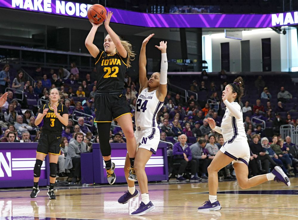 Iowa Hawkeyes guard Kathleen Doyle (22) shoots during the third quarter of their game at Welsh-Ryan Arena in Evanston, Ill. on Sunday, January 5, 2020. (Stephen Mally/hawkeyesports.com)
