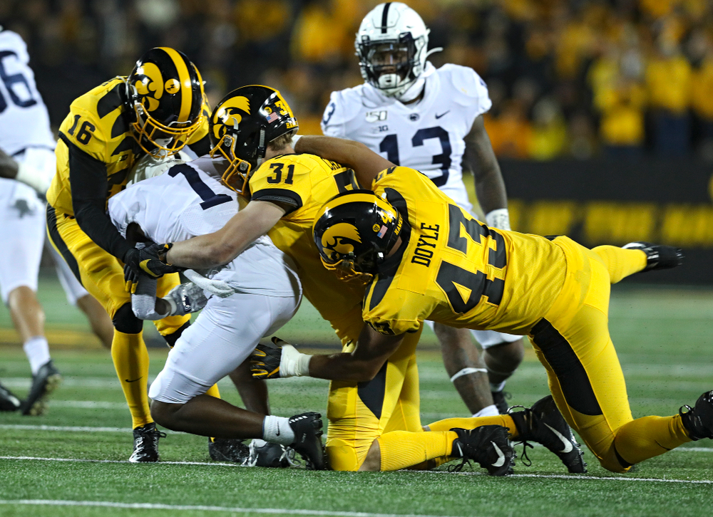 Iowa Hawkeyes defensive back Terry Roberts (16), linebacker Jack Campbell (31), and linebacker Dillon Doyle (43) bring down Penn State Nittany Lions wide receiver KJ Hamler (1) on a kickoff return during the first quarter of their game at Kinnick Stadium in Iowa City on Saturday, Oct 12, 2019. (Stephen Mally/hawkeyesports.com)