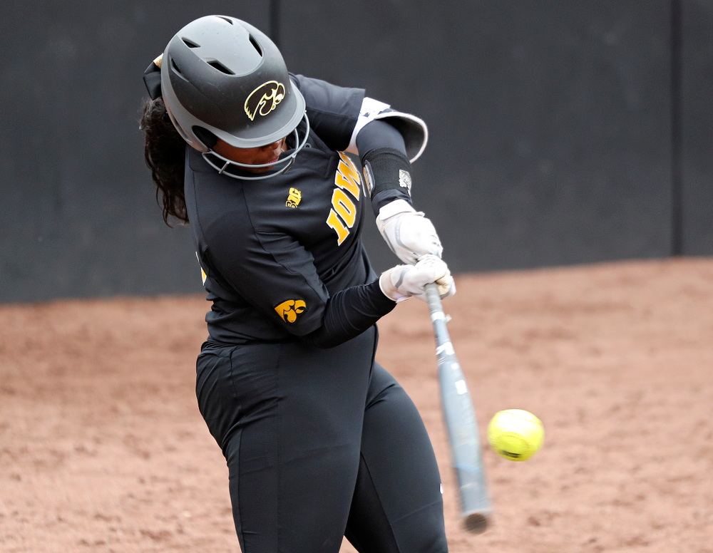 Iowa's DoniRae Mayhew (24) hits a 3-run home run during the sixth inning of their game against Iowa Softball vs Indian Hills Community College at Pearl Field in Iowa City on Sunday, Oct 6, 2019. (Stephen Mally/hawkeyesports.com)