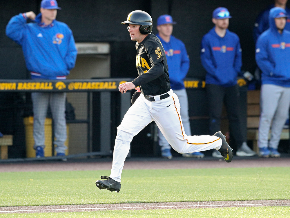 Iowa outfielder Ben Norman (9) scores a run during the fourth inning of their college baseball game at Duane Banks Field in Iowa City on Tuesday, March 10, 2020. (Stephen Mally/hawkeyesports.com)