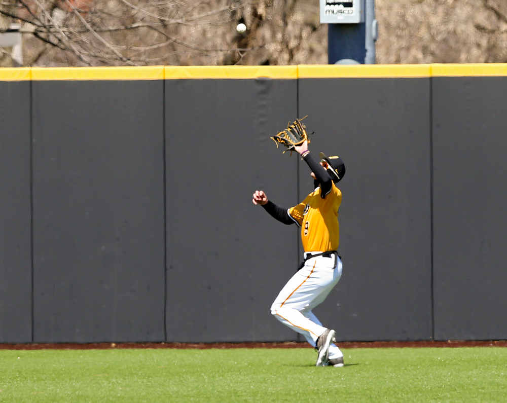 Iowa Hawkeyes center fielder Ben Norman (9) pulls in a fly ball for an out during the first inning against Illinois at Duane Banks Field in Iowa City on Sunday, Mar. 31, 2019. (Stephen Mally/hawkeyesports.com)