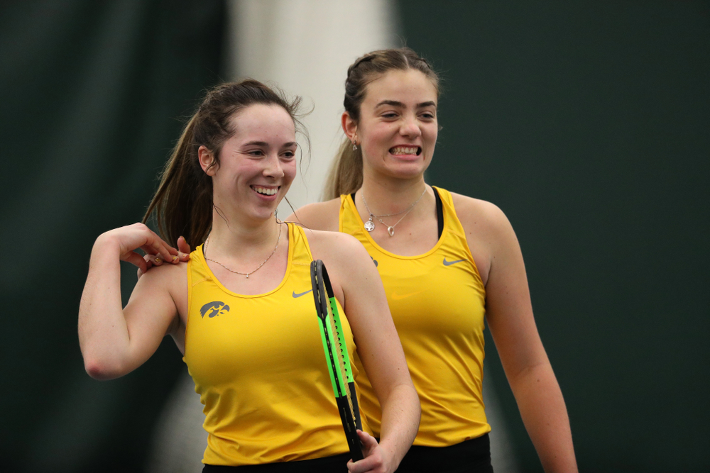 Iowa's Sam Mannix and Sophie Clark celebrate after winning their doubles match against Xavier Friday, January 18, 2019 at the Hawkeye Tennis and Recreation Center. (Brian Ray/hawkeyesports.com)