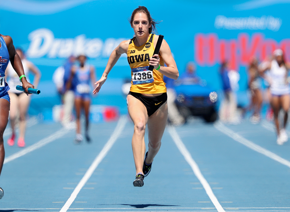 Iowa's Talia Buss runs in the women's 400 meter relay event during the second day of the Drake Relays at Drake Stadium in Des Moines on Friday, Apr. 26, 2019. (Stephen Mally/hawkeyesports.com)