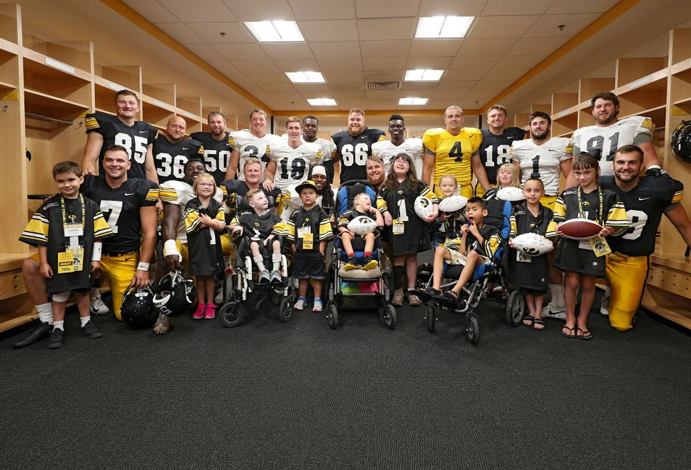 The 2019 Kid Captains with Iowa players during Kids Day at Kinnick Stadium in Iowa City on Saturday, Aug 10, 2019. (Stephen Mally/hawkeyesports.com)