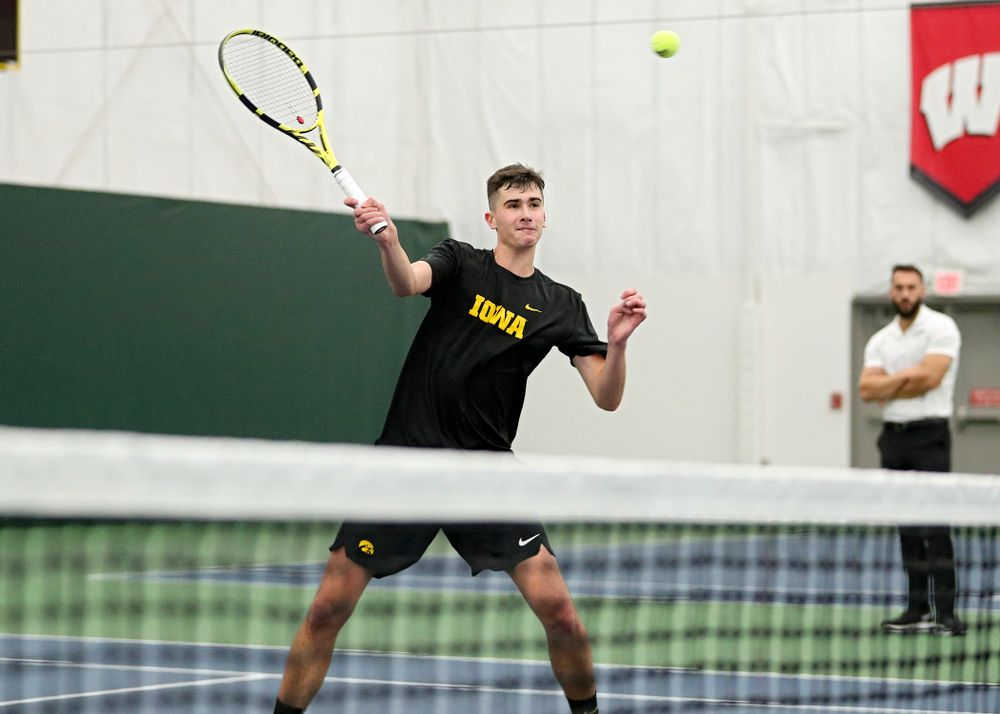 Iowa's Matt Clegg returns a shot during his doubles match at the Hawkeye Tennis and Recreation Complex in Iowa City on Thursday, January 16, 2020. (Stephen Mally/hawkeyesports.com)